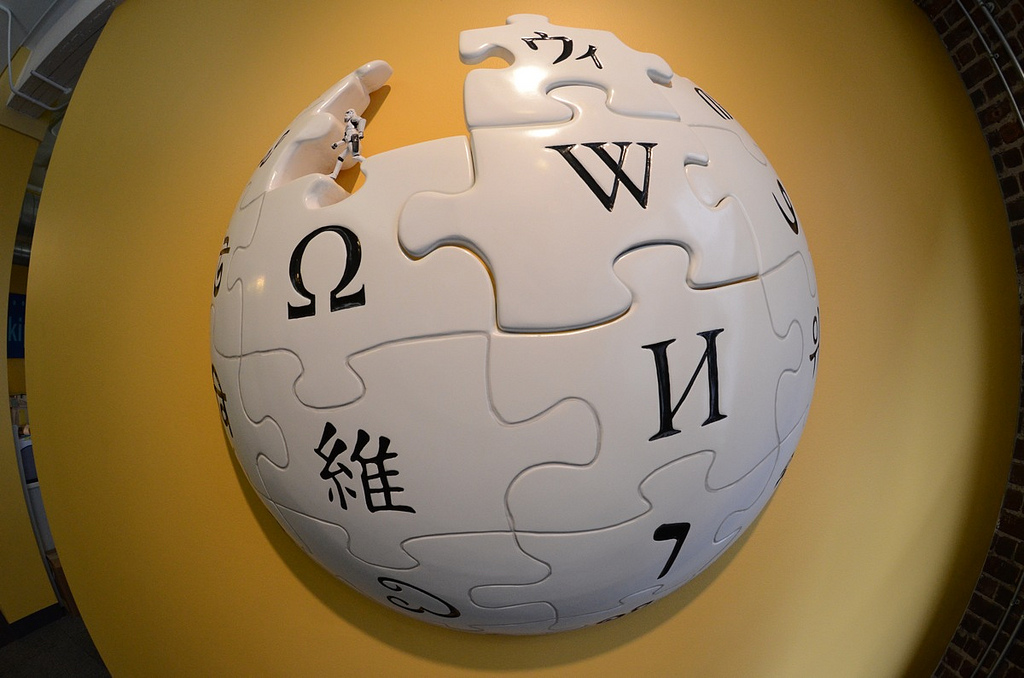 Wikipedia Logo on Yellow Wall
